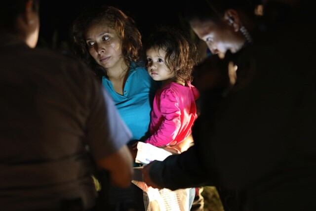 Migrant girl show on Time cover is with her mother
