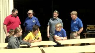 Helena High students build picnic tables for Camp Child