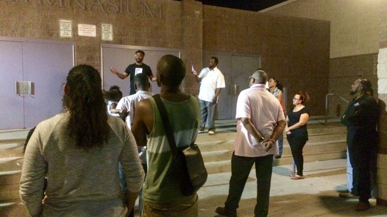 Community pleading for peace at vigil