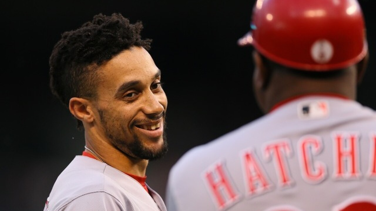 Lamb shuts down Rockies as Reds win 7-2