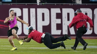 Yuri Andrade eludes security after running onto field during Super Bowl LV