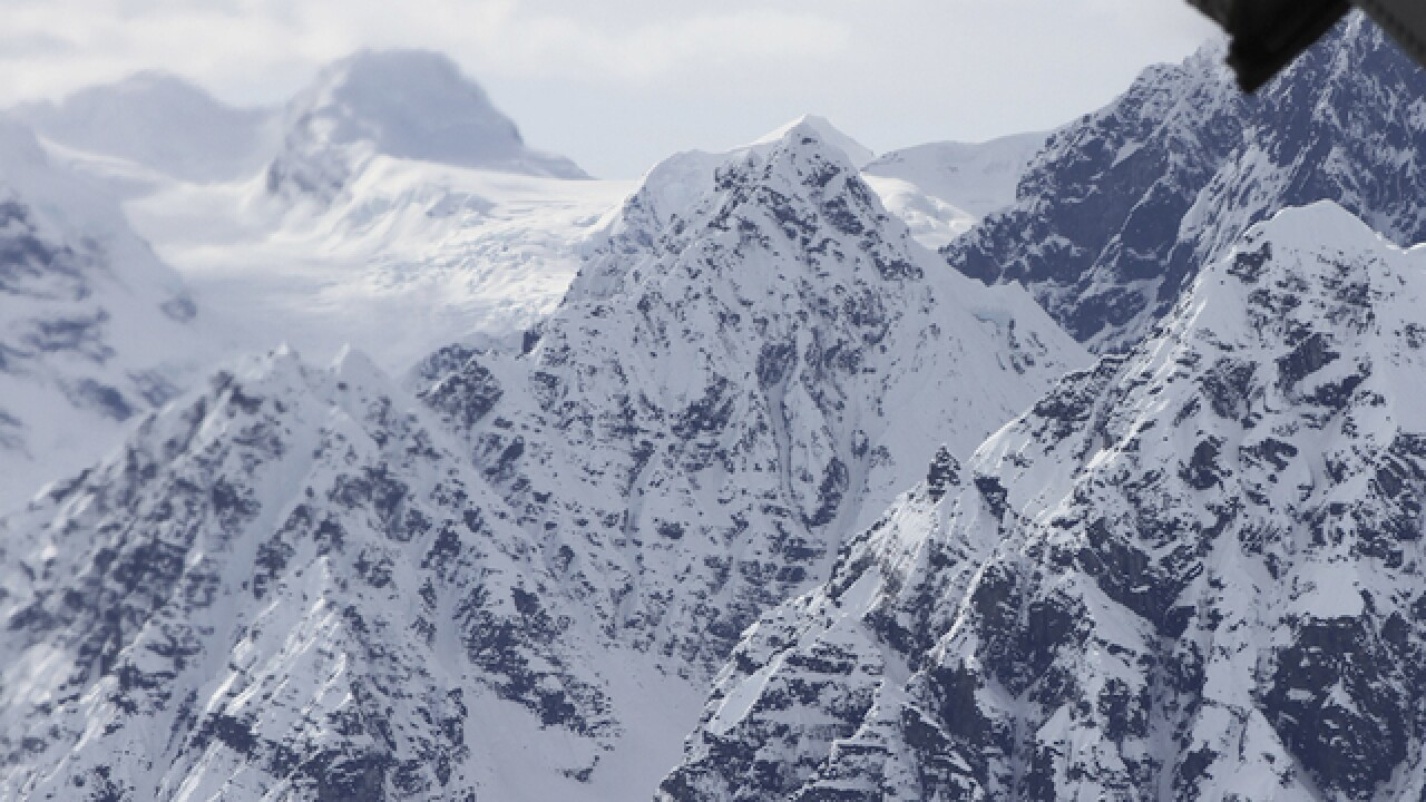 Fallen climber chipped from ice by rescuers on Alaska mountain