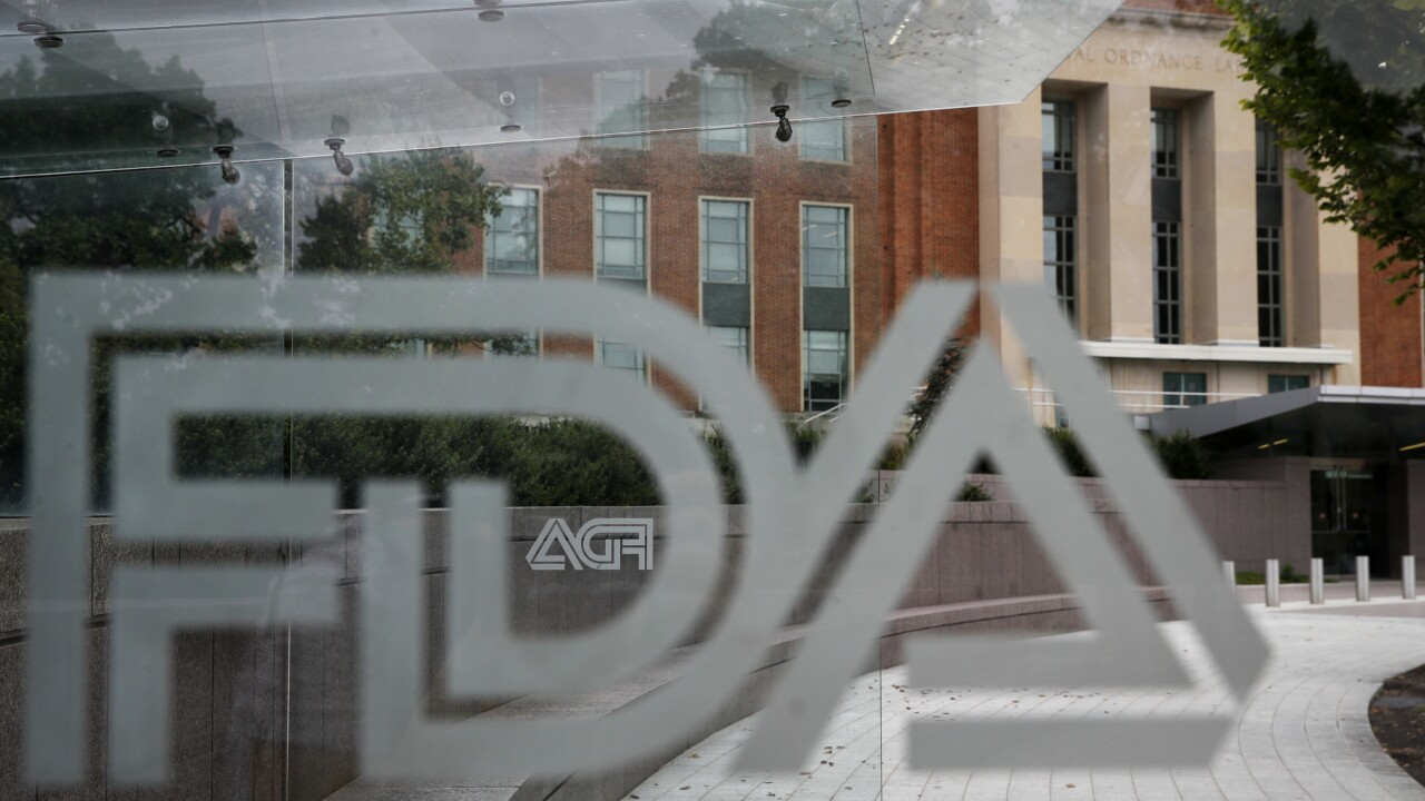This Thursday, Aug. 2, 2018 photo shows the U.S. Food and Drug Administration building behind FDA logos at a bus stop on the agency's campus in Silver Spring, Md.