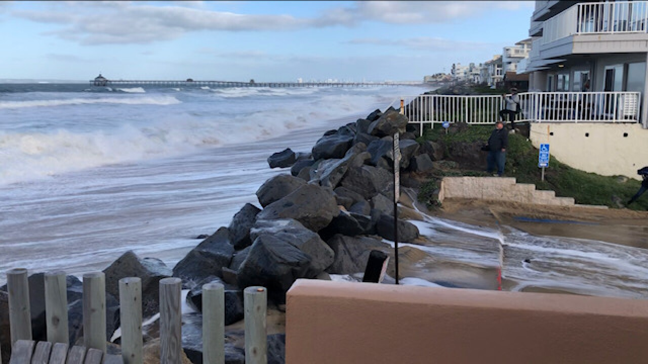 High surf causes water to spill into Imperial Beach street