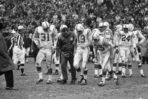 Don Shula helps injured Johnny Unitas with Baltimore Colts in 1965