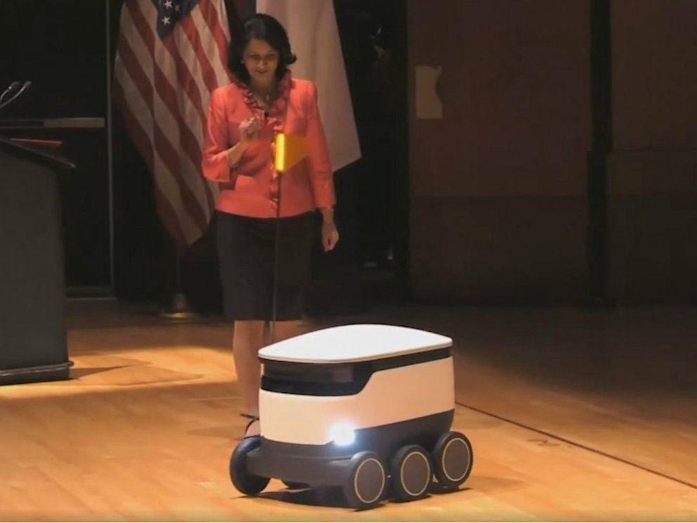 University of Houston President Renu Khator demonstrates an autonomous food delivery robot during her annual fall address, Sept. 2, 2019. University of Houston via KTRK