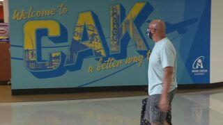 Passengers walk through Akron-Canton Airport