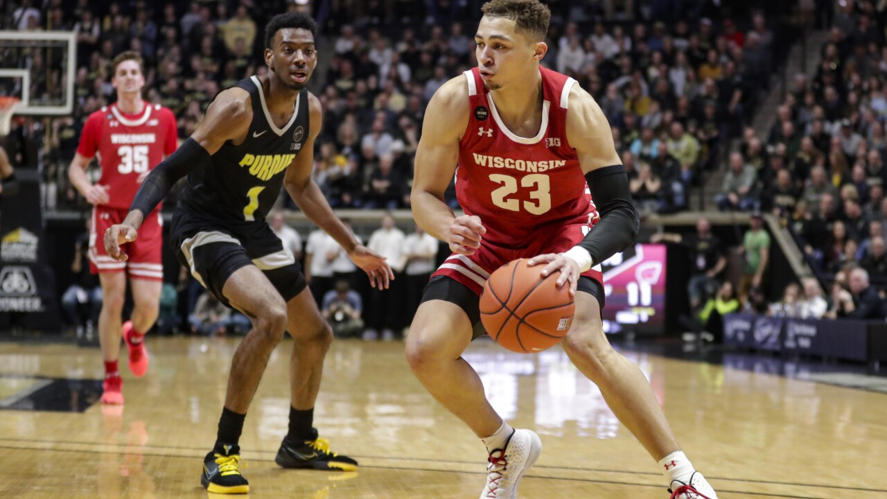 Wisconsin guard Kobe King (23) drives on Purdue forward Aaron Wheeler (1) during the first half of an NCAA college basketball game in West Lafayette, Ind., Friday, Jan. 24, 2020. (AP Photo/Michael Conroy)
