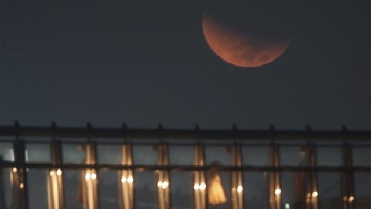 PHOTOS: Stargazers catch rare supermoon eclipse