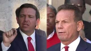Gov. Ron DeSantis and suspended Broward County Sheriff Scott Israel