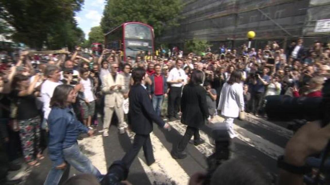 Fans flock to Abbey Road on the 50th anniversary of the Beatles' classic photo