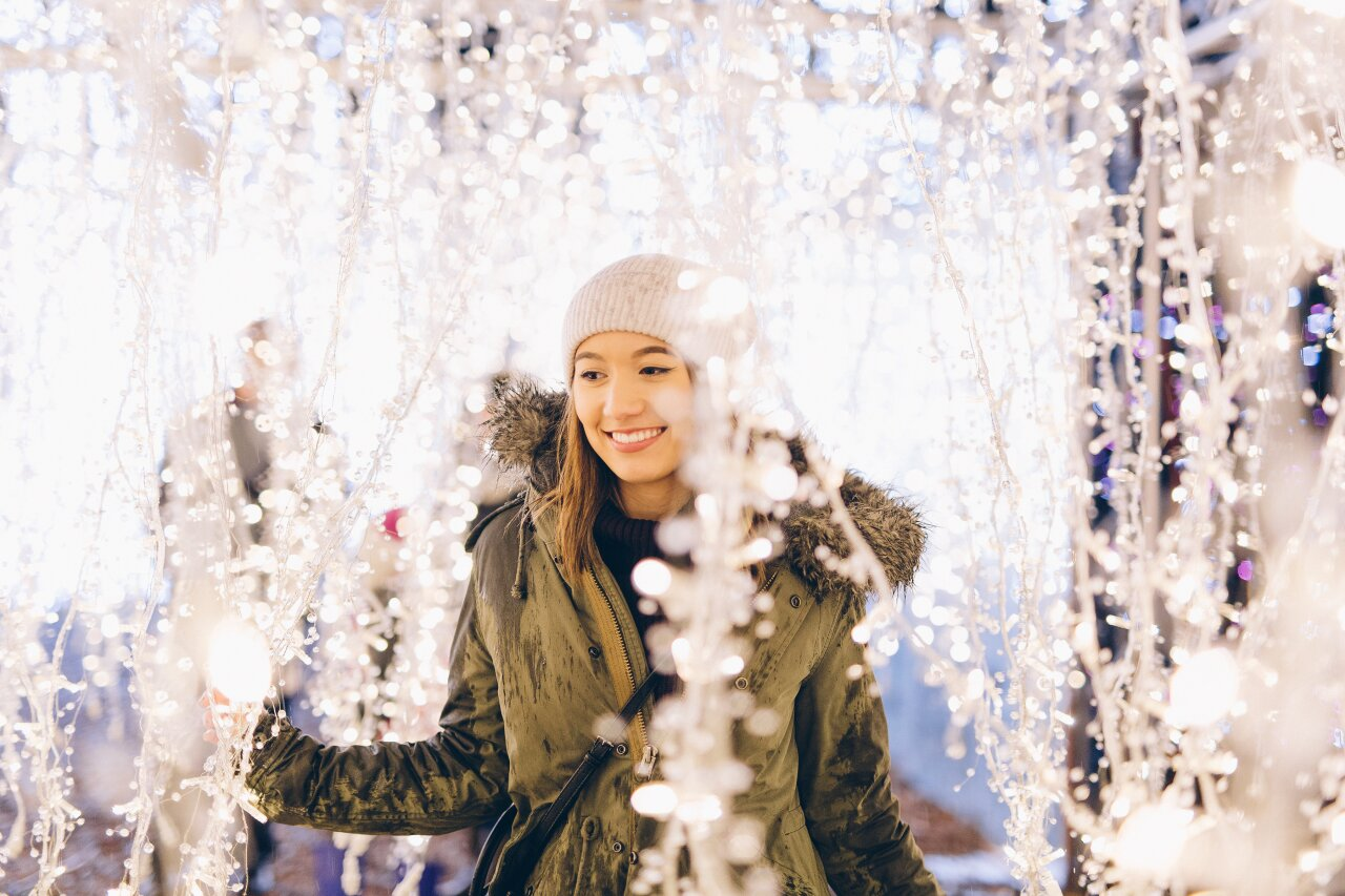 Enchant-Christmas-Young-Woman-Dangling-Lights.jpg
