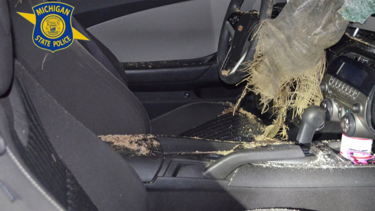 A Michigan man has been arrested for throwing 40-pound sandbags off an overpass that hit a woman's car, seriously injuring her.