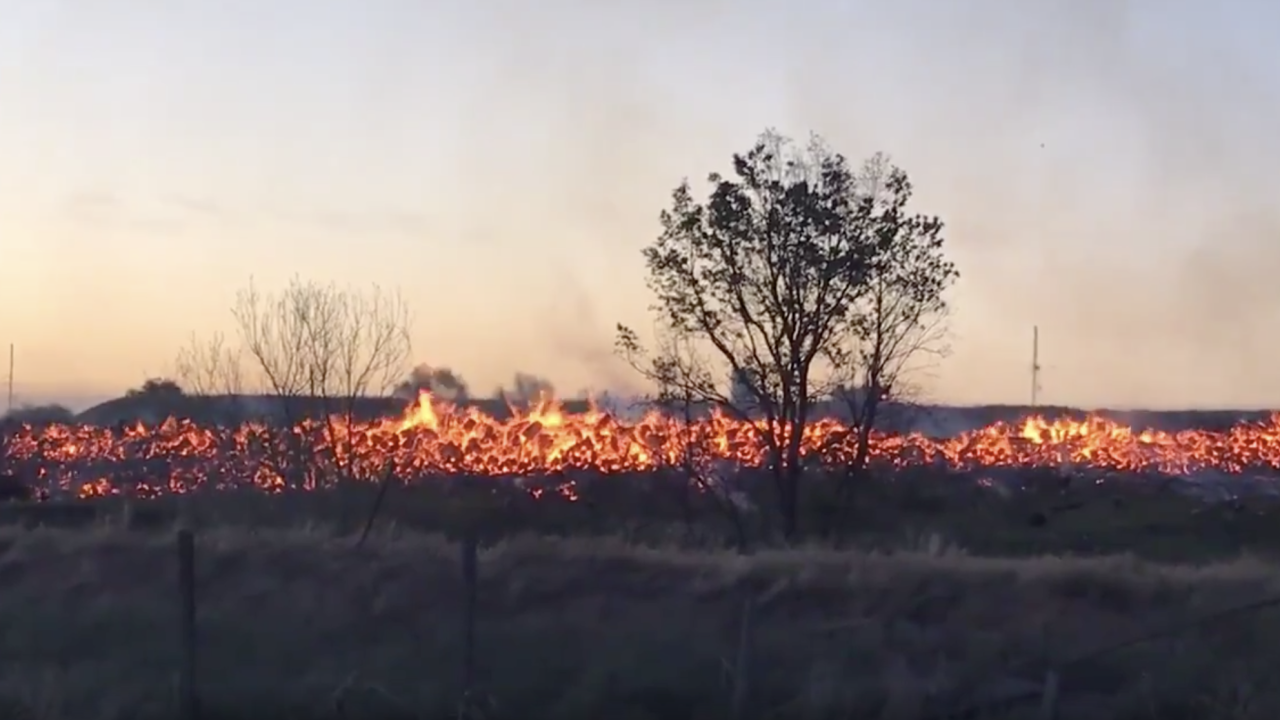 Large grass fire burning next to I-270 along Adams County