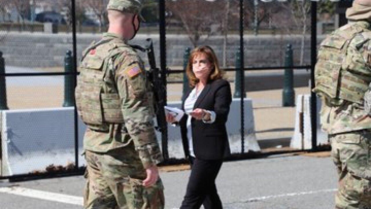 Rep. Lisa McClain with MI Natl Guard via Twitter 2.jpg
