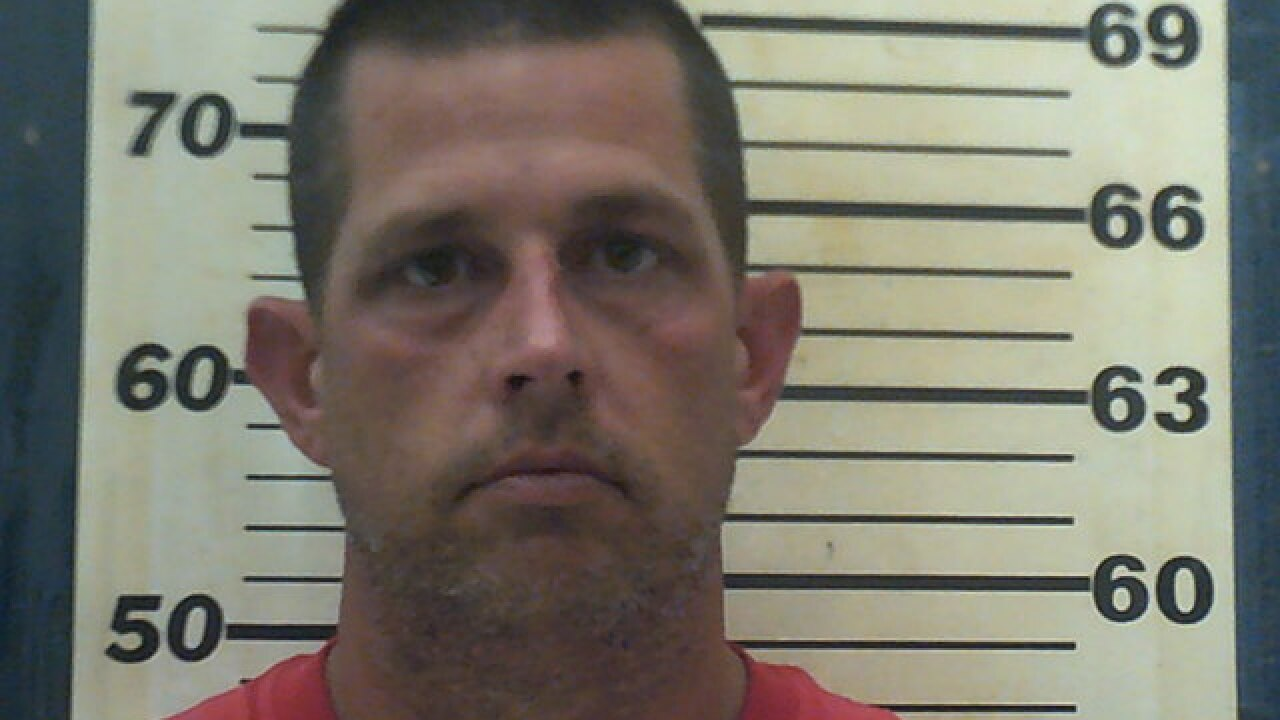 Locust Grove police chief arrested, accused of assaulting wife