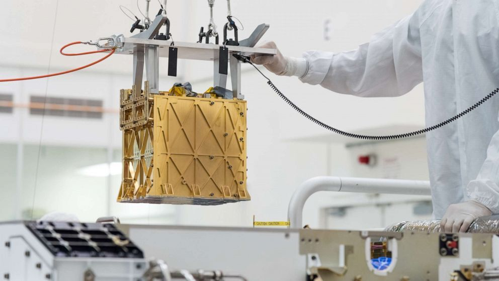 The Mars Oxygen In-Situ Resource Utilization Experiment (MOXIE) instrument is lowered into the Perseverance rover, March 21, 2019 at NASA's Jet Propulsion Laboratory, in Pasadena, Calif.