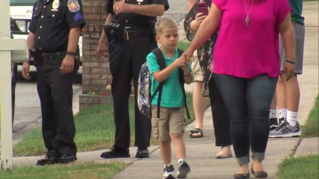 Local police take Lt. Allan's son to school