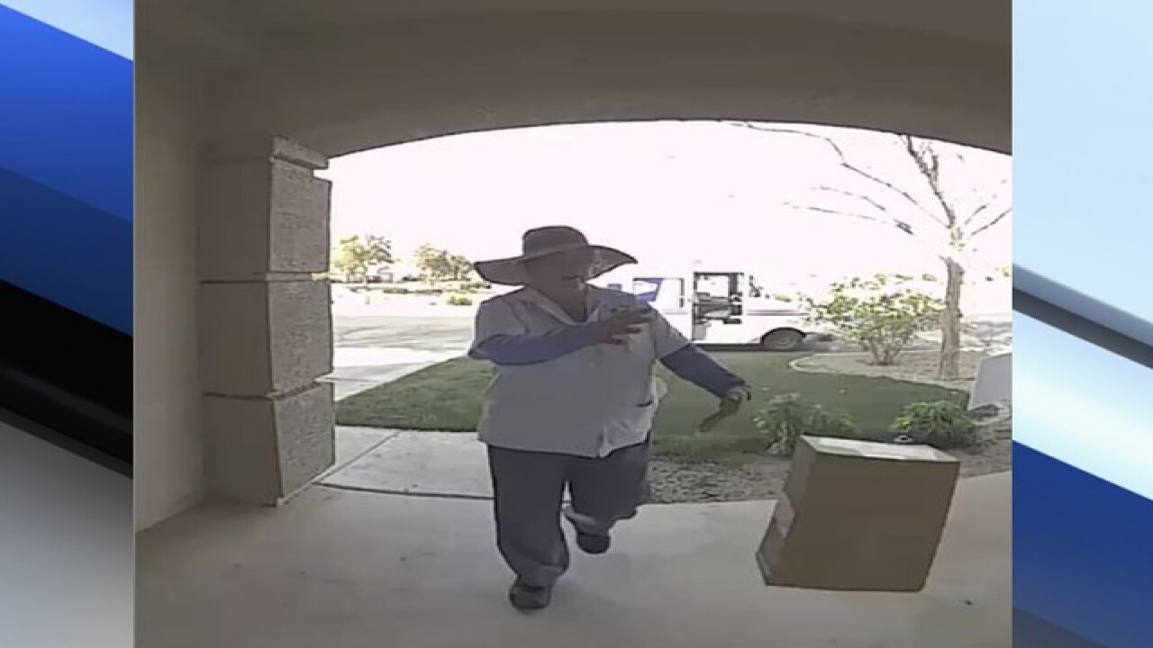 Doorbell camera records postal service carrier dropping