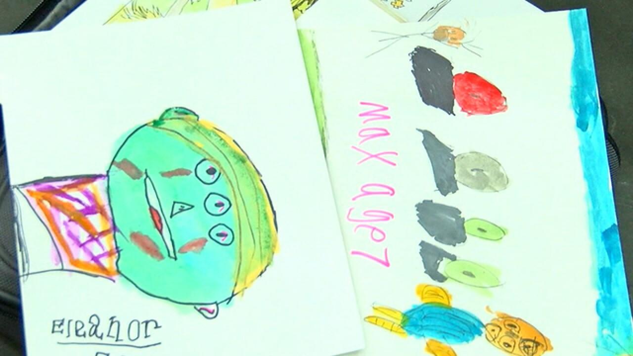 Artist swaps drawings for kids' monsters