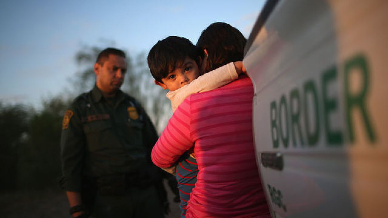 AP Exclusive: About 2,000 minors separated from families