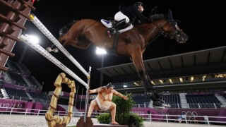 Spooky sumo display may be making some Olympic horses jumpy