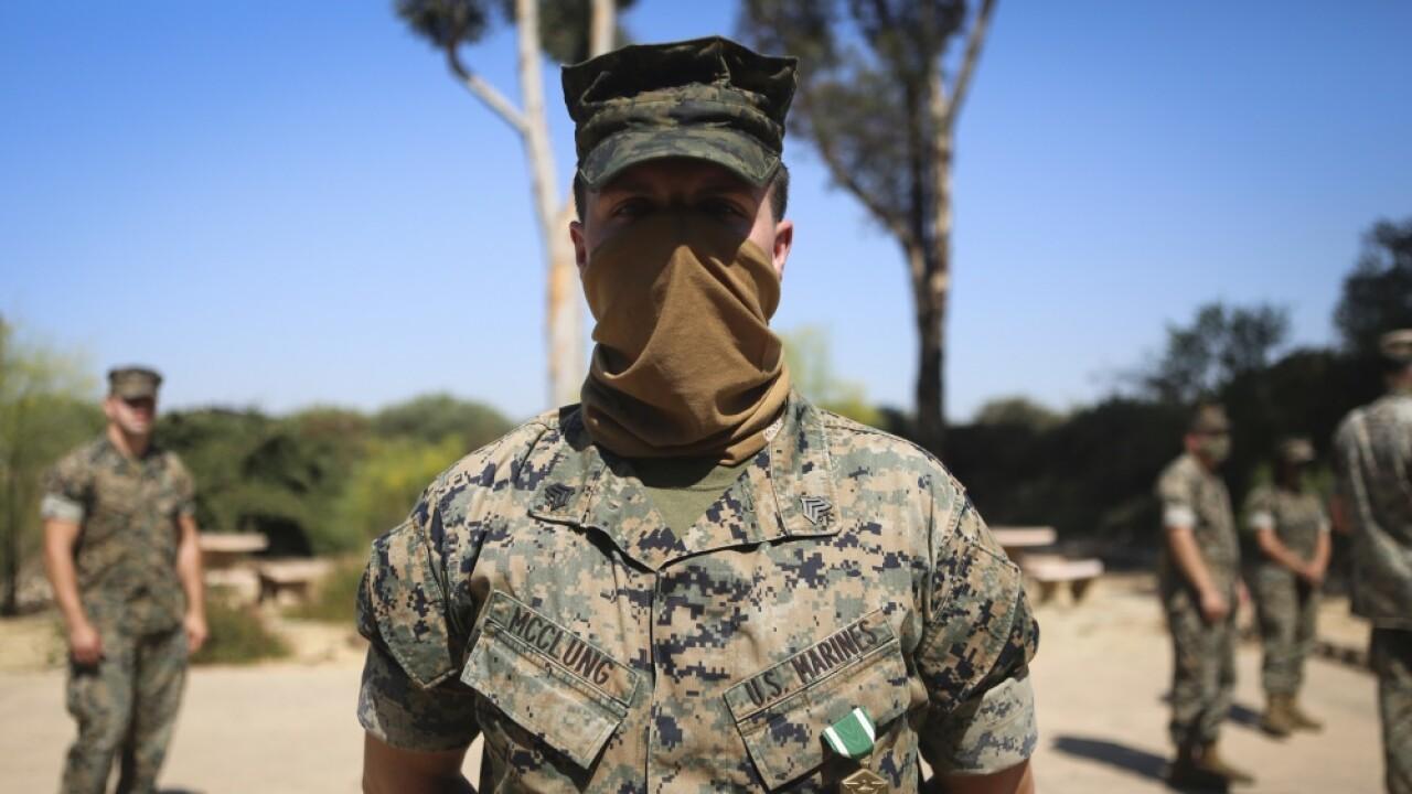 Marine honored for protecting neighborhood