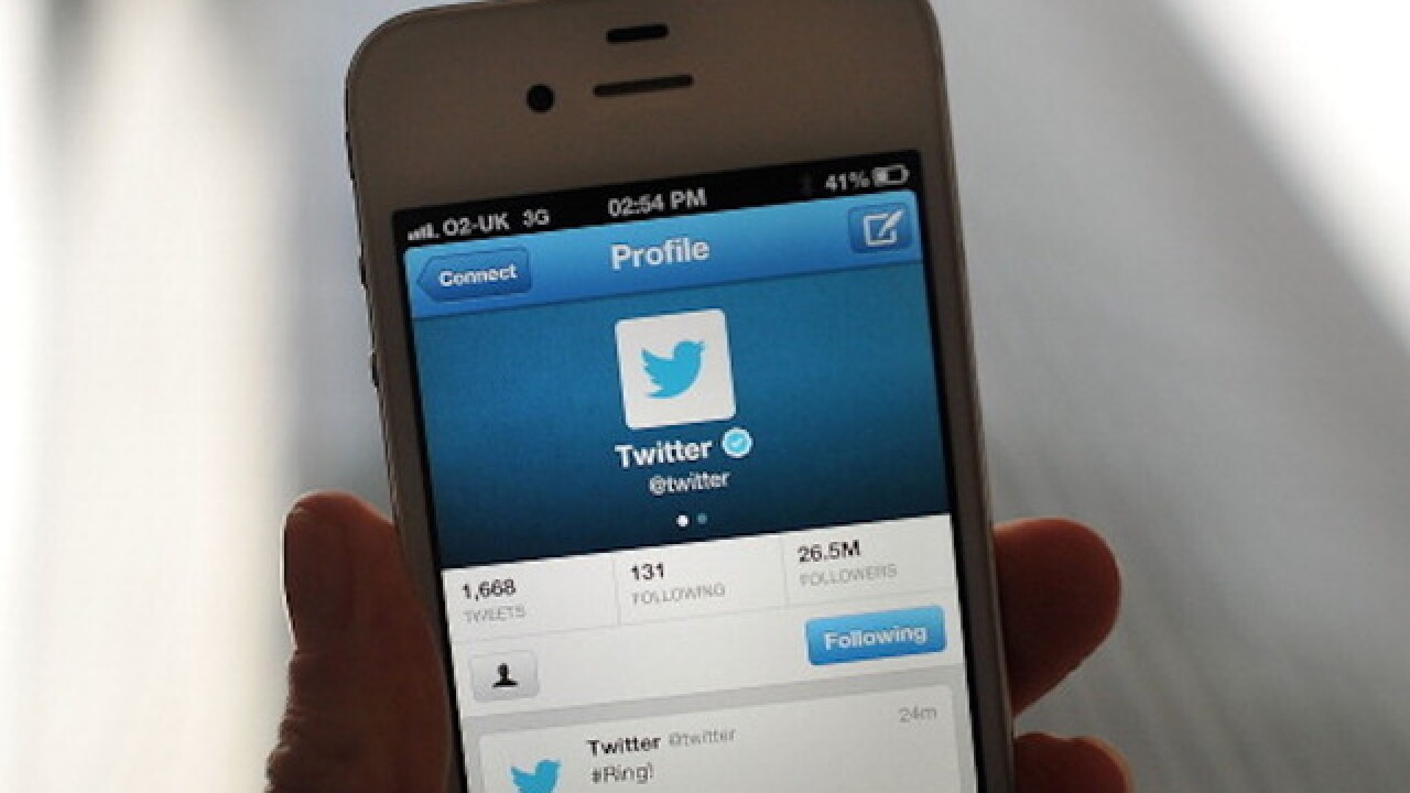 Officer re-hired after threatening tweets