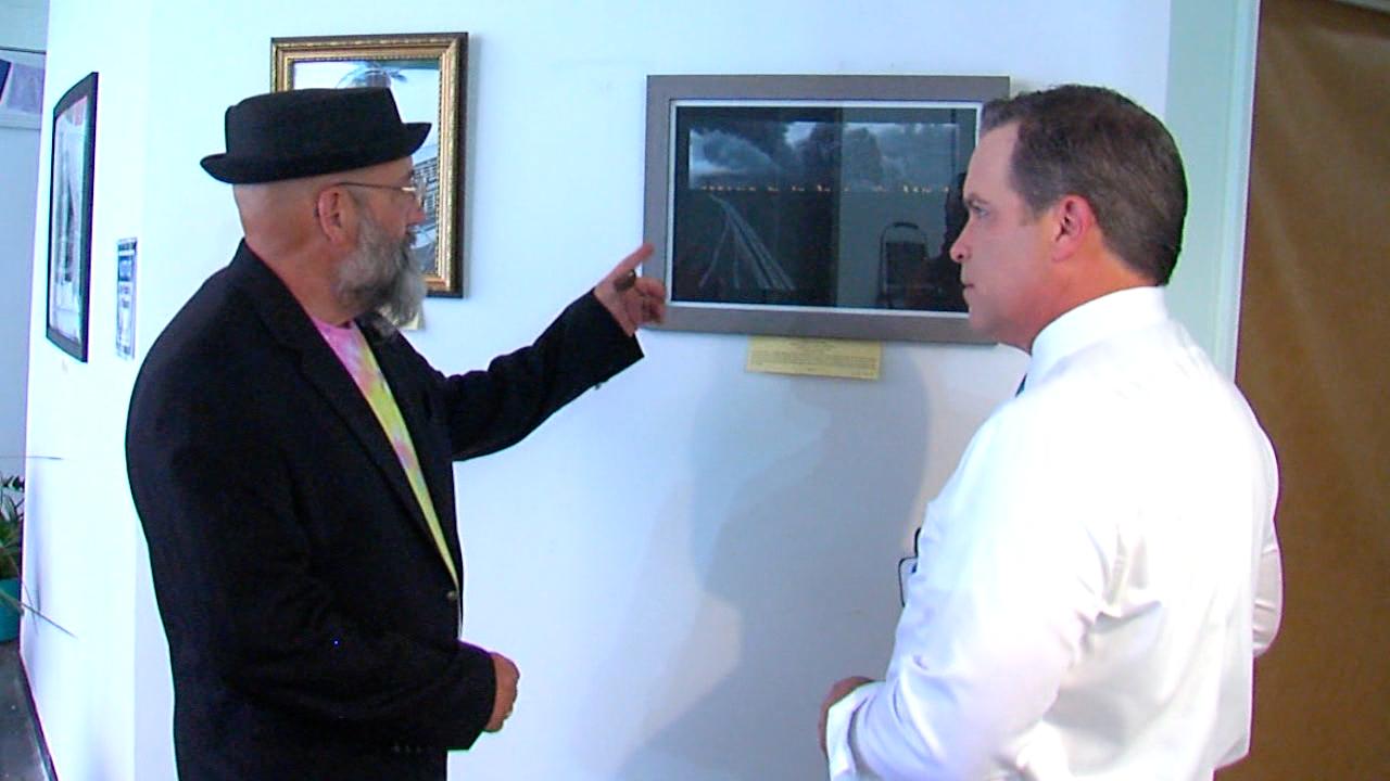 David McGee showing Craig McKee a painting