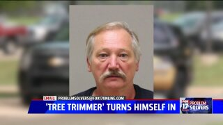 Wanted 'tree trimmer' turns himself in to authorities