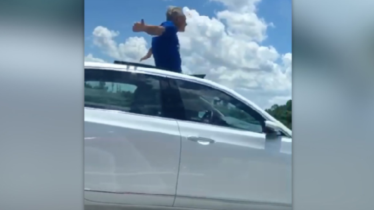 Florida Driver On I 4 Stands Through Moon Roof Leaving