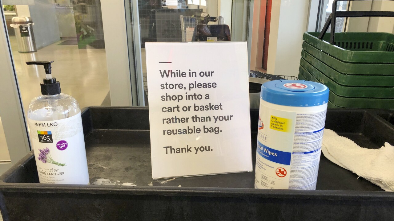 Plastic bag bans reversed as shoppers asked not to use reusable bags during crisis