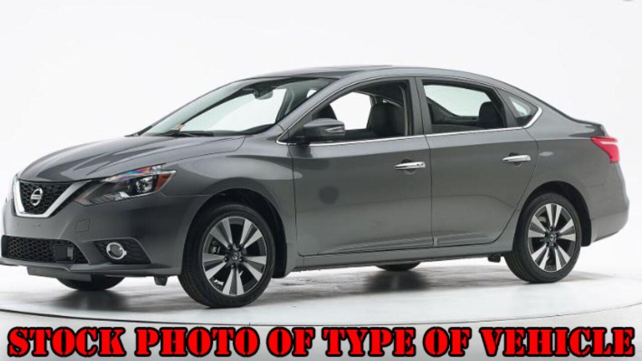 Stock photo of gray Nissan Sentra.