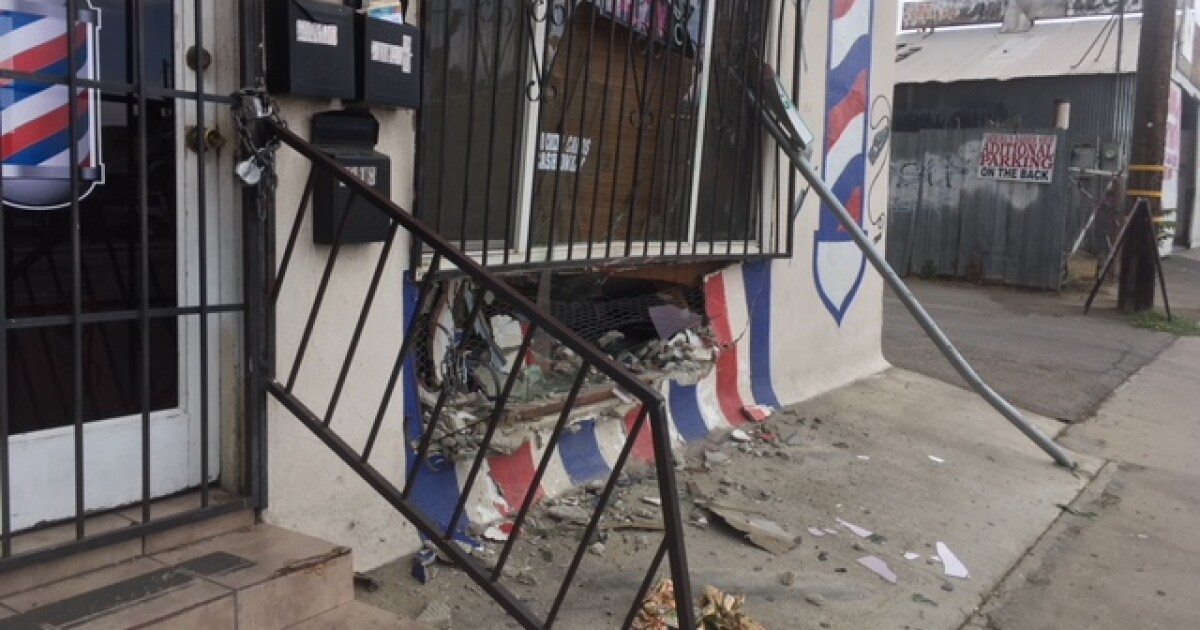 Officials: Car reportedly strikes front of Bertha's Barber Shop, no injuries