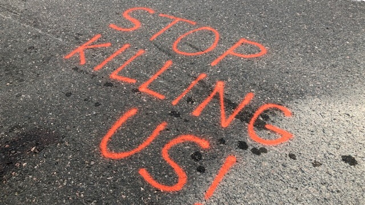 Message on pavement at accident site