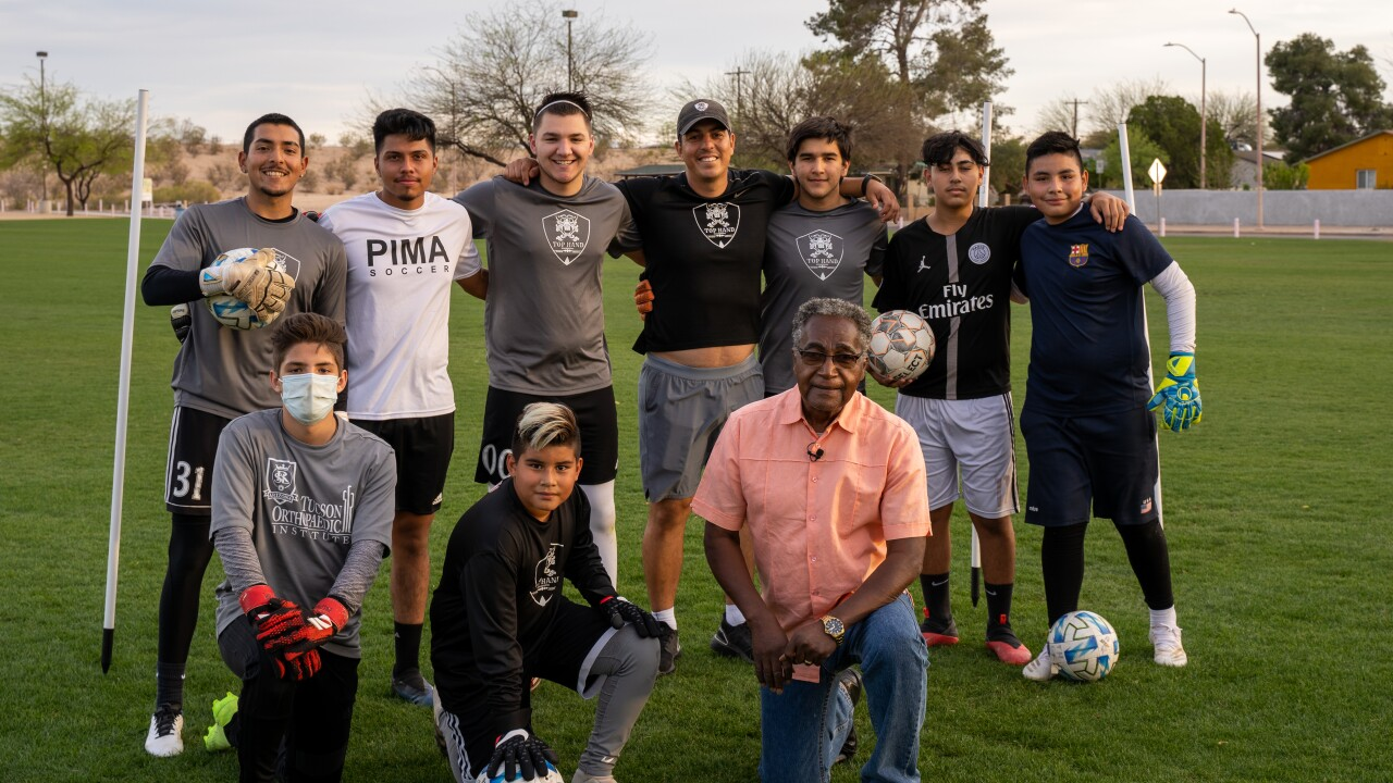 Willie Blake Jr. and soccer players practicing in his park