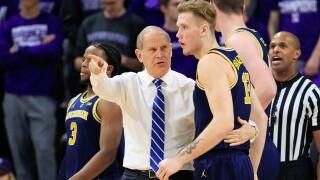 No. 5 Michigan holds off Northwestern