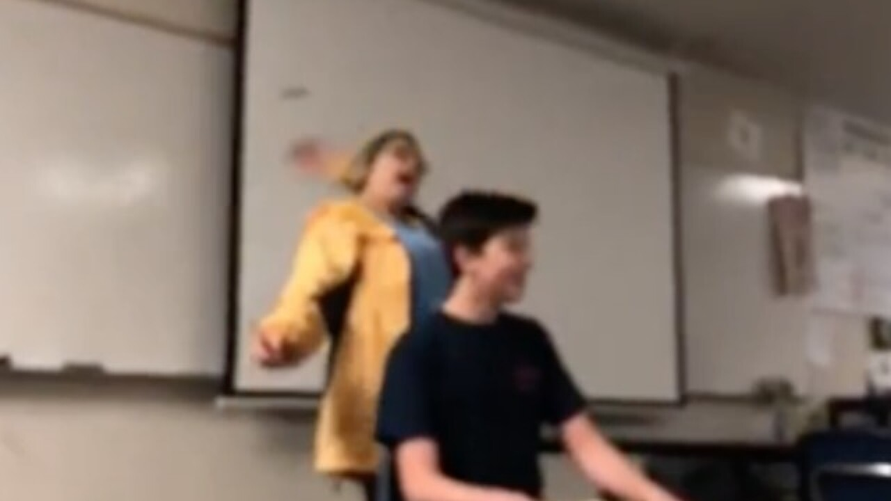 Calif. teacher arrested after video shows her cutting students' hair while singing national anthem