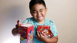 Ace-Marasigan-son-with-snack-boxes.jpg