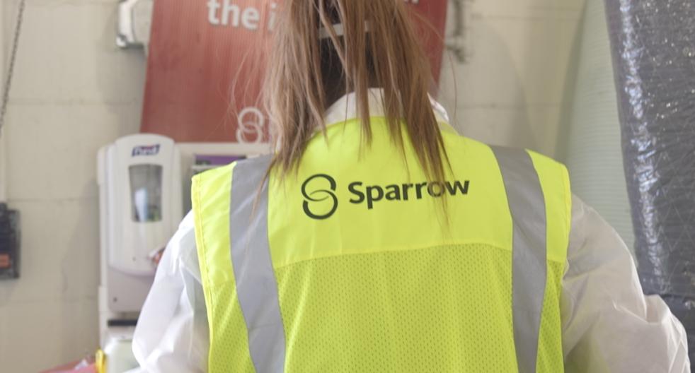 Sparrow lab technician prepares PCR test for a patient at the Frandor testing site