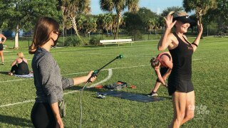 Water is sprayed on to an Orangetheory employee to cool her off as she works out in Lilac Park in Palm Beach Gardens.