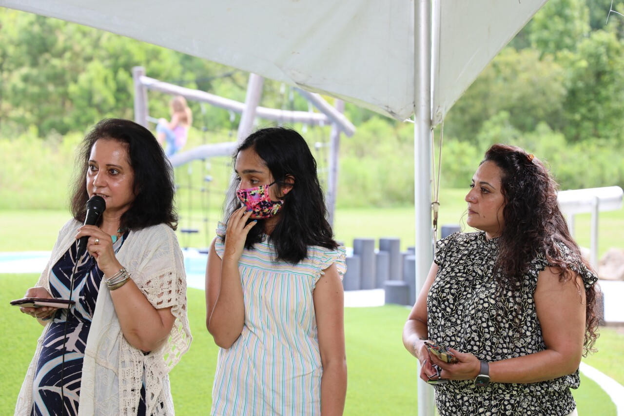 """Parwez """"P.A."""" Alam's sister gives some touching words about the former County Administrator at the Parwez """"P.A."""" Alam Park dedication. PC: Leon County  Pictured (left to right): Ghazala Alam, P.A.'s sister, Zahra Alam, P.A.'s daughter; Adeena Alam, P.A.'s daughter"""