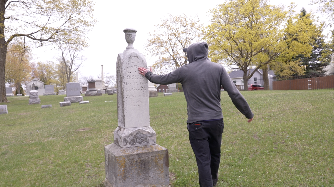 Cleaning gravestones in Mt. Rest Cemetery in St. Johns