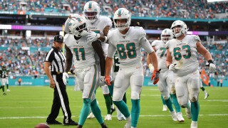DeVante Parker #11 of the Miami Dolphins celebrates catching a touchdown against the New York Jets in the second quarter at Hard Rock Stadium on November 03, 2019 in Miami, Florida.