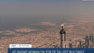 Ad shows woman on top of tallest building?