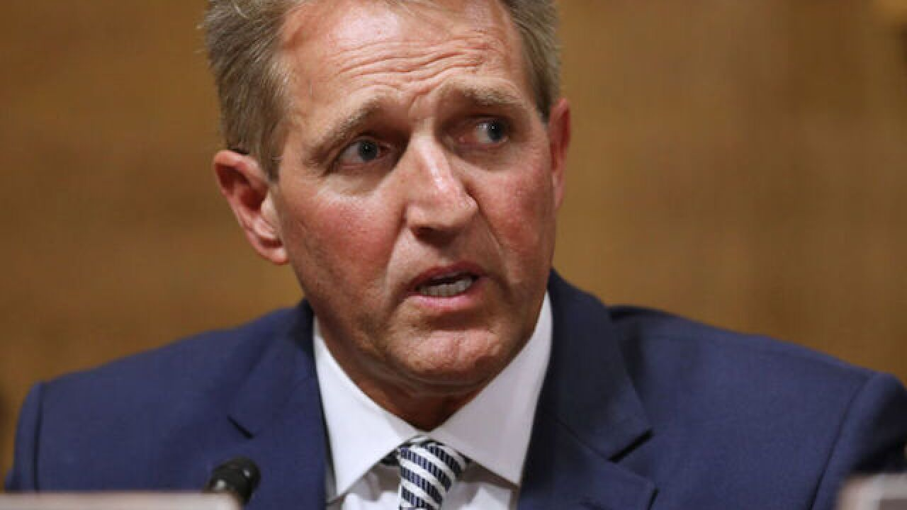 Flake says his Kavanaugh vote depends on FBI probe results