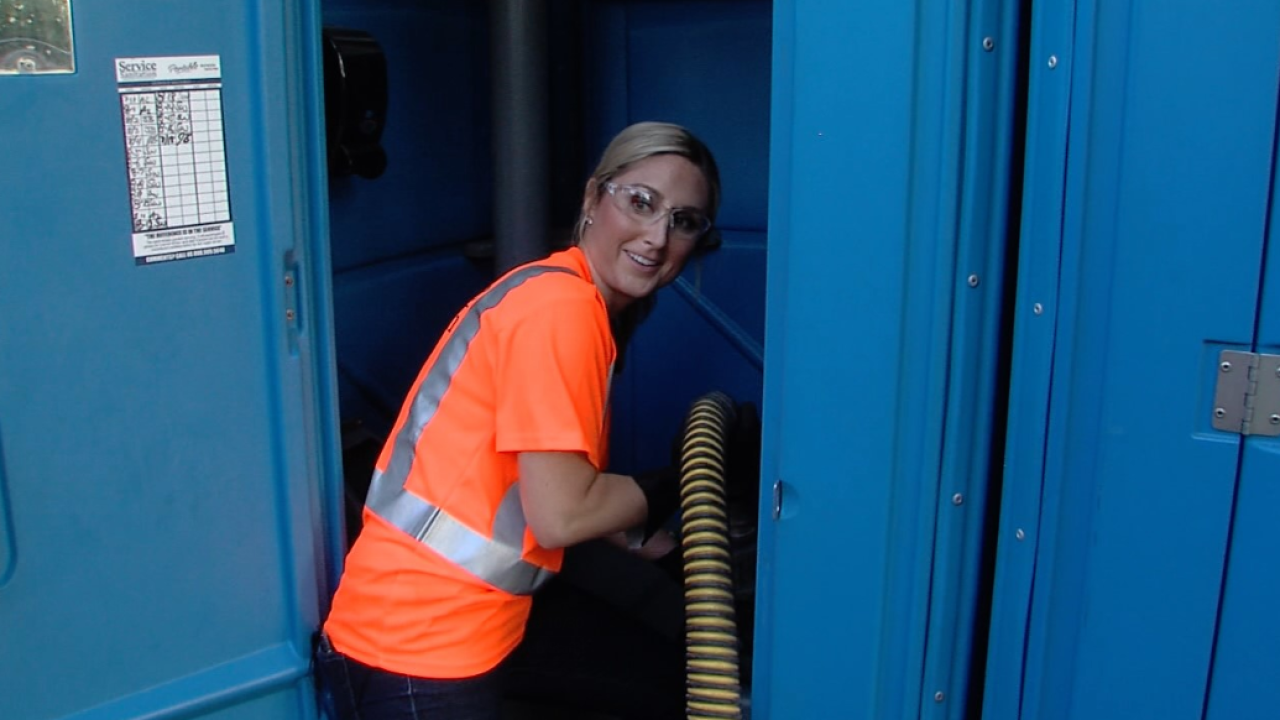 meredith in porta potty.PNG