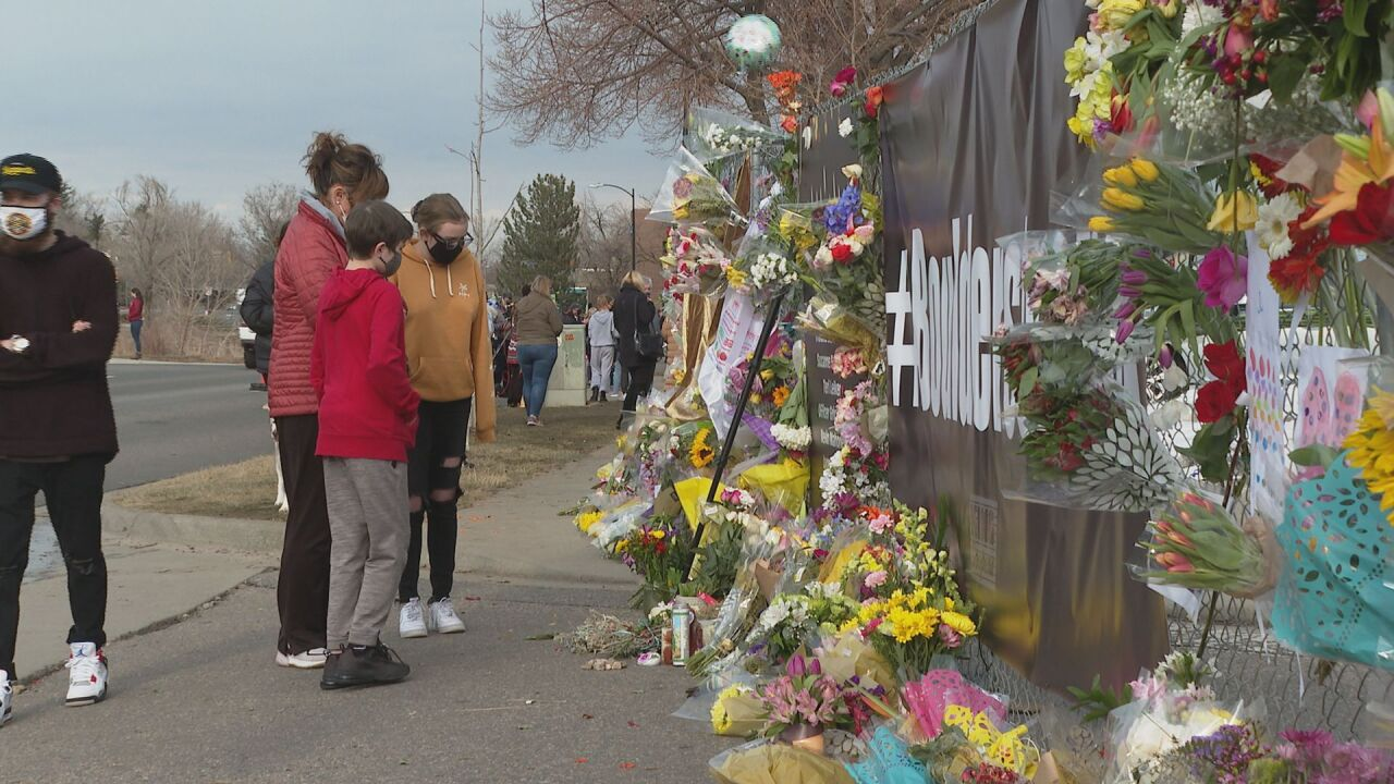 People pay their respects at the site of the Boulder mass shooting
