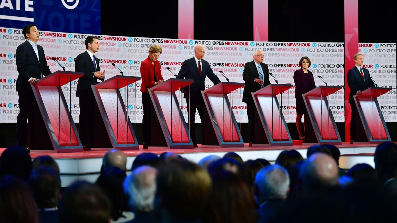 (From L) Democratic presidential hopefuls, entrepreneur Andrew Yang, Mayor of South Bend, Indiana Pete Buttigieg, Massachusetts Senator Elizabeth Warren, former Vice President Joe Biden, Vermont Senator Bernie Sanders, Minnesota Senator Amy Klobuchar and businessman Tom Steyer participate of the sixth Democratic primary debate of the 2020 presidential campaign season co-hosted by PBS NewsHour & Politico at Loyola Marymount University in Los Angeles, California on December 19, 2019. (Photo by Frederic J. Brown / AFP) (Photo by FREDERIC J. BROWN/AFP via Getty Images)