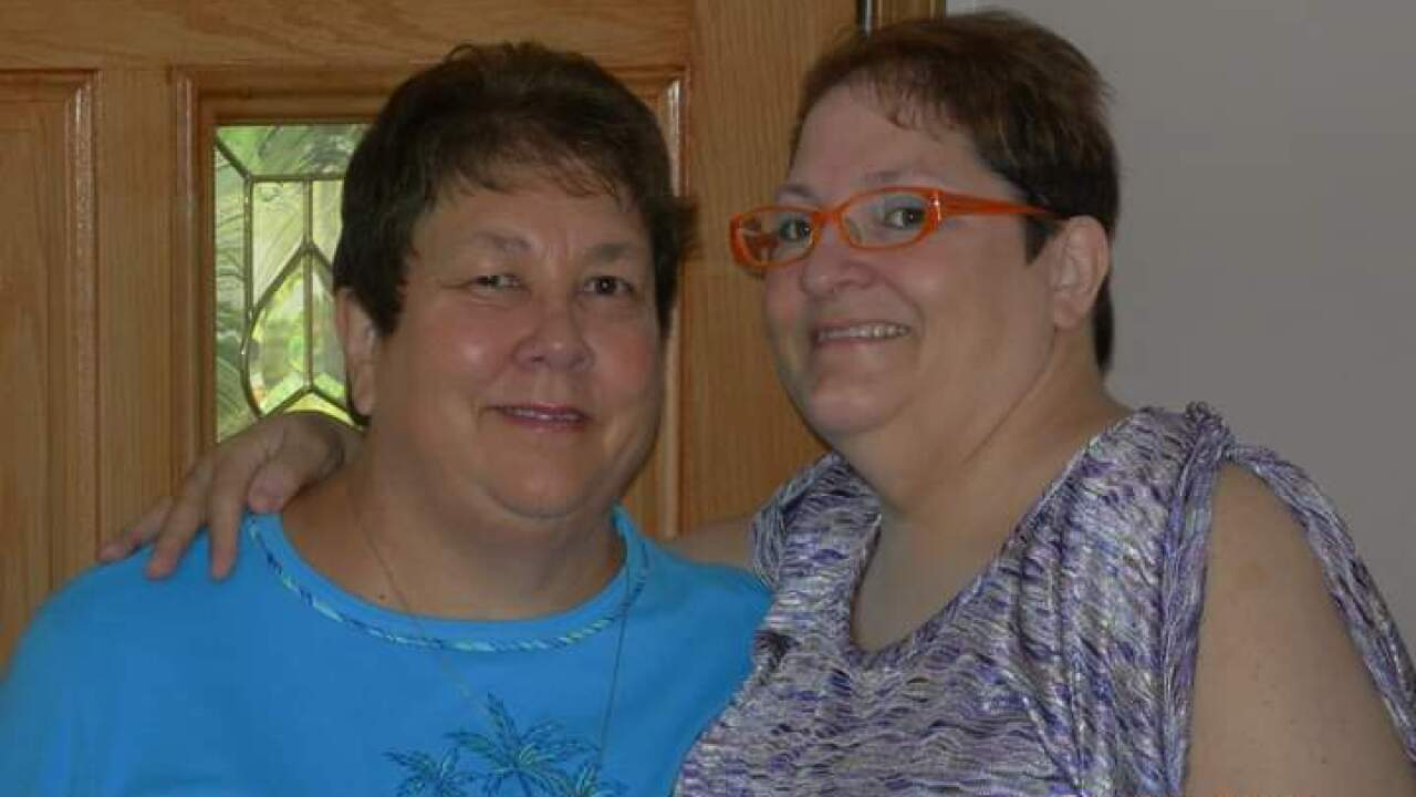 Teola Hornaday (right) is concerned about scams in which scammers pose as Amazon customer service and target senior citizens like her mother, Katrina (left).
